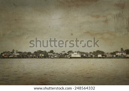 Rural old riverfront house in Thailand, vintage style - stock photo