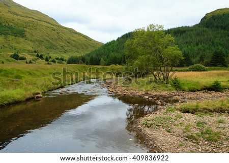Rural panorama from Scotland. Green hills from Highlands region. Travel destinations - stock photo