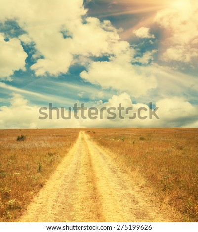 Rural road and blue sky with sun. Copyspace, future concept.