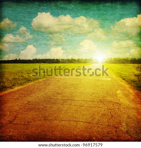 Rural road at sunset in grunge and retro style. - stock photo