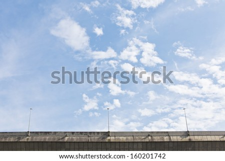 Rural road on a blue sky day - stock photo