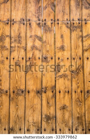Rural rough yellow wood texture background with rivets.