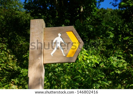 Rural sign post for hiking trails - stock photo