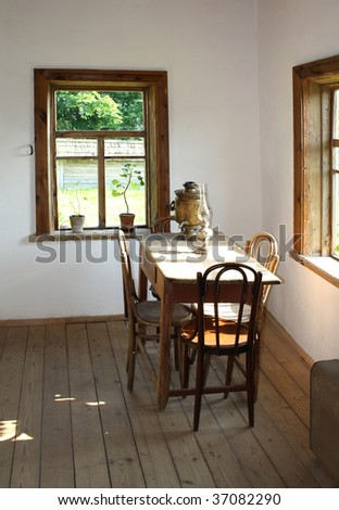 Rural simple interior in old village cottage - stock photo