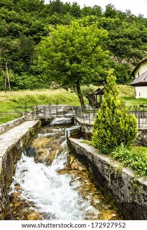 Rural summer landscape with stream, Montenegro, Monastery Morachich - stock photo