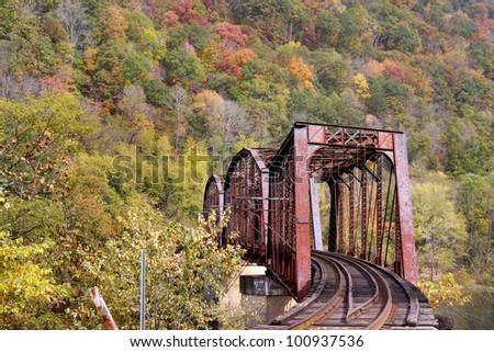 Rural train track in west virginia mountains in autumn time - stock photo