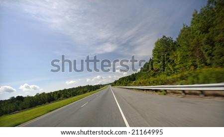 Rural U.S. highway, plenty of cropping room - stock photo