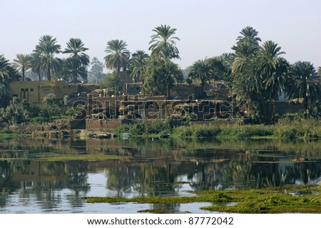 rural waterside scenery with River Nile in Egypt (Africa) at evening time - stock photo