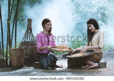 Rural women cleaning Rice, Selection of traditional rice varieties.