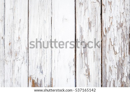 Rural wood plank fence with an old paint white color close up. Detailed background photo texture. Wooden wall abstract background.