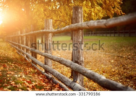 rural wooden fence. natural autumn background - stock photo