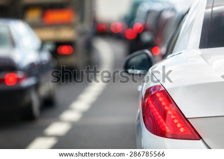 Rush hour traffic congestion focus on tail brake light - stock photo