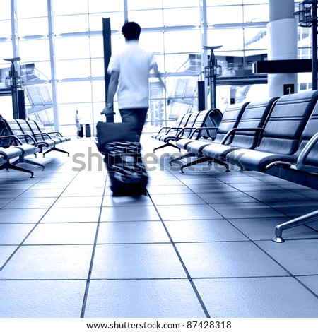 rushed passengers in the airport waiting room. - stock photo