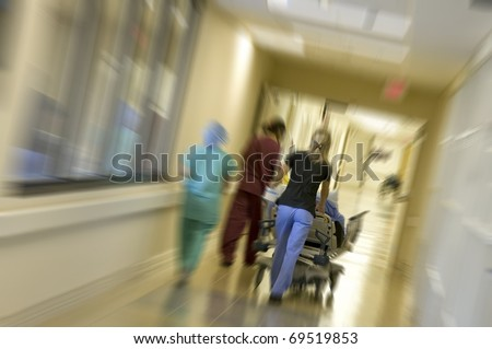 Rushing a patient to the emergency room for surgery with motion - stock photo