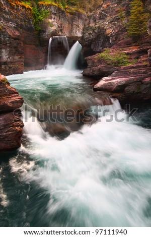 Rushing waters of Saint Mary Falls at Glacier National Park - USA - stock photo