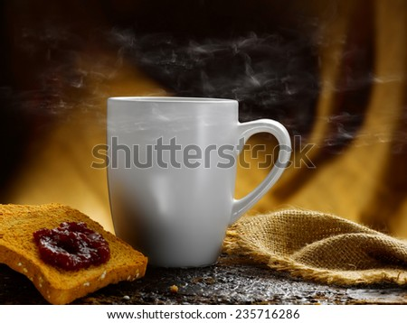 rusks jam and steaming hot coffee - stock photo