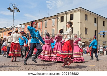 """RUSSI, RA, ITALY - AUGUST 3: folk group """"Cossack song and dance ensemble Volnaya Step"""" from Stavropol, Russia, at the International Folklore Festival of Russi, on August 3, 2014 in Russi, RA, Italy   - stock photo"""