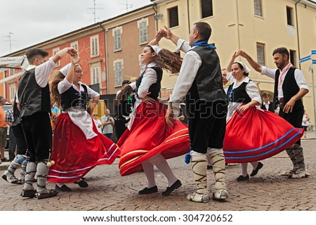 RUSSI, RA, ITALY - AUGUST 2: italian folk dance ensemble Irizema from Calabria performs traditional tarantella during the International Folklore Festival, on August 2, 2015 in Russi, Ravenna, Italy