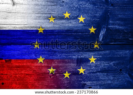 Russia and European Union Flag painted on old wood plank texture - stock photo