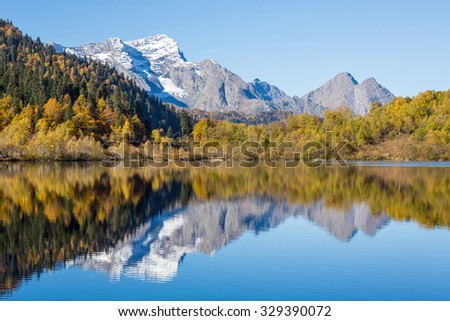 Russia. Caucasus. Rocks are reflected in the lake.