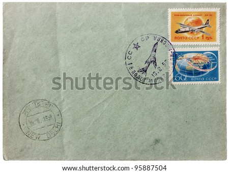 """RUSSIA - CIRCA 1958: a set of two stamps printed by USSR shows Soviet airplanes. Postmarks from Moscow and New Delhi. Text in the image means: """"First flight from Moscow to Delhi"""", circa 1958. - stock photo"""