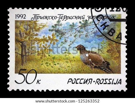 "RUSSIA - CIRCA 1992: A stamp printed in Russia shows a partridge with inscription and name of series ""Prioksko - Terrasny Nature Reserve"", circa 1992"