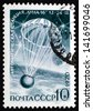 RUSSIA - CIRCA 1970: a stamp printed in the Russia shows Luna 16, Capsule Landing on Earth, Unmanned Automatic Moon Mission, circa 1970 - stock photo
