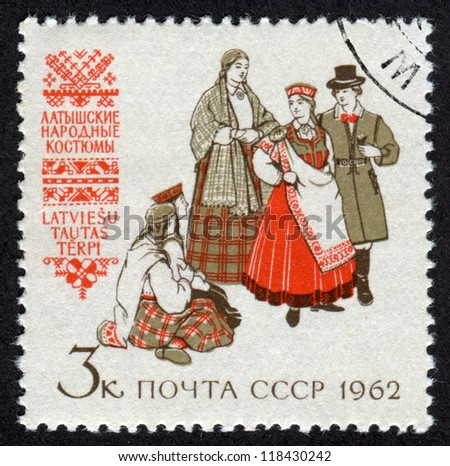 RUSSIA - CIRCA 1962: A stamp printed in USSR (Soviet Union), shows Regional Folk Costumes. Latvian Folk Costumes, Scott catalog A1237 circa 1962 - stock photo