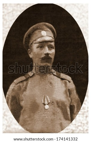 RUSSIA - CIRCA 1914 - 1917: An antique photo portrait of the soldier of the Russian imperial army of times of First  World War, circa 1914 - 1917 - stock photo