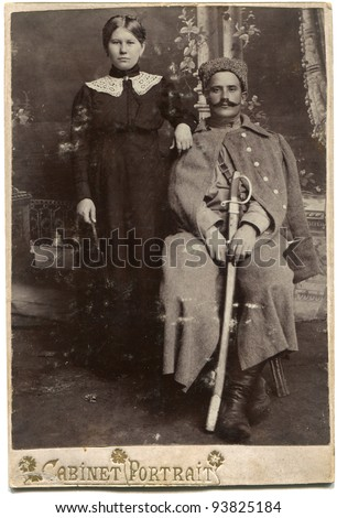 RUSSIA - CIRCA  1914 - 1917: An antique photo shows woman and a soldier with a sword in his hand, the Russian Empire during the First World War - stock photo