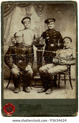 RUSSIA - CIRCA  period of the First World War: An antique photo shows four soldiers, the Russian Empire, period of the First World War Russian text: Art photography