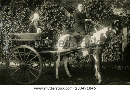 RUSSIA - CIRCA  1900s:  Vintage photo shows man and woman in a horse cart. - stock photo