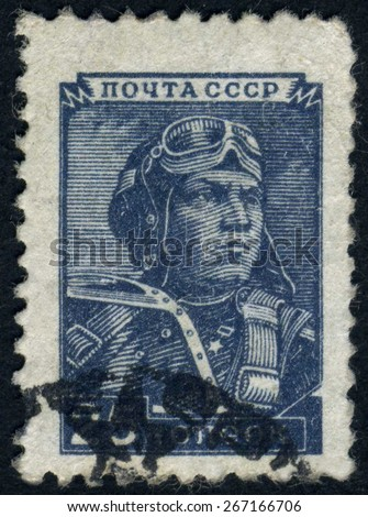 RUSSIA - circa 1952: stamp printed by Russia, shows Soviet aviator, pilot, old plane circa 1952 - stock photo