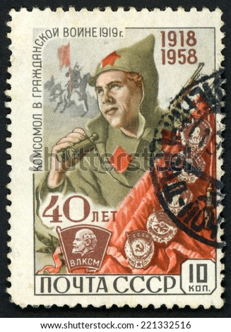 RUSSIA - CIRCA 1958: stamp printed in USSR (CCCP, soviet) shows young civil war soldier holding field glasses; 40th anniversary of communist league Komsomol; Scott 2135 A1116 10k red green, circa 1958 - stock photo