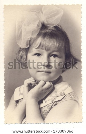 RUSSIA - CIRCA 1958 Vintage photo shows studio portrait of an unidentified a little girl posing as actor  - stock photo