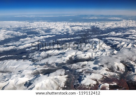 Russia, Far East, the Kamchatka peninsula, view of the mountains from the window of the airplane - stock photo