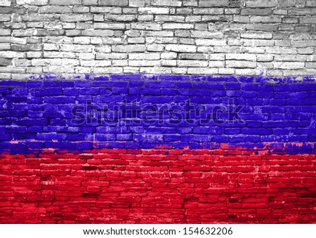 Russia flag painted on old brick wall - stock photo