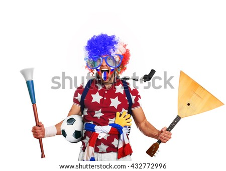 Russia football fan in a red wig and horns - stock photo