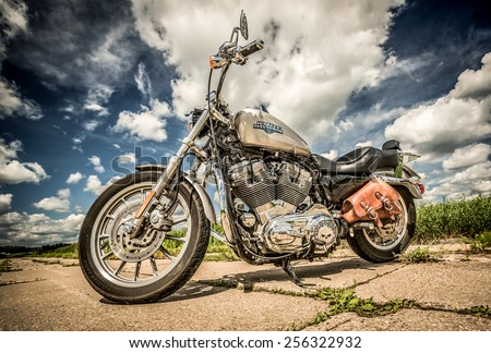 RUSSIA-JULY 7, 2013: Harley-Davidson Sportster 883 Low. Harley-Davidson sustains a large brand community which keeps active through clubs, events, and a museum. Filter applied in post-production. - stock photo
