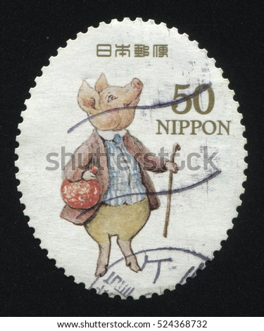 RUSSIA KALININGRAD, 22 APRIL 2016: stamp printed by Japan, shows pig in clothes, circa 2011