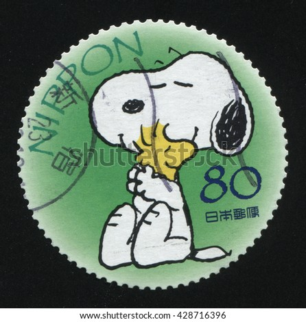 RUSSIA KALININGRAD, 22 APRIL 2016: stamp printed by Japan shows Snoopy, circa 2012 - stock photo
