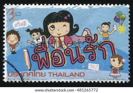 RUSSIA KALININGRAD, 2 JUNE 2016: stamp printed by Thailand, shows cartoon smiling kids, circa 2013