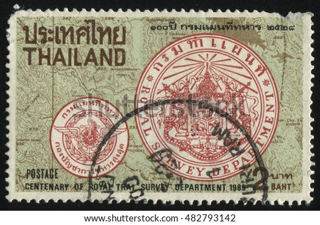 RUSSIA KALININGRAD, 2 JUNE 2016: stamp printed by Thailand, shows emblem of royal trai survey department on topographic map background, circa 1985