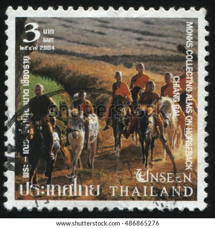 RUSSIA KALININGRAD, 4 JUNE 2016: stamp printed by Thailand, shows monks collecting alms on horseback, chiang bai, circa 2004