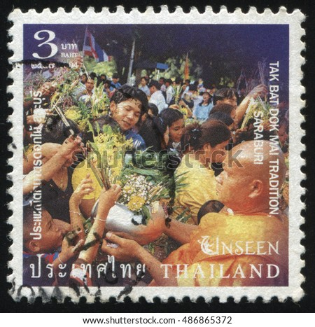RUSSIA KALININGRAD, 3 JUNE 2016: stamp printed by Thailand, shows people, giving flowers to monks on celebration, circa 2004