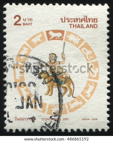 RUSSIA KALININGRAD, 3 JUNE 2016: stamp printed by Thailand, shows person in mask on the tiger, circa 1998