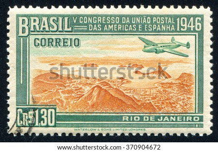RUSSIA KALININGRAD, 13 MARCH 2014: stamp printed by Brazil, shows  aircraft and mountain, circa 1946 - stock photo