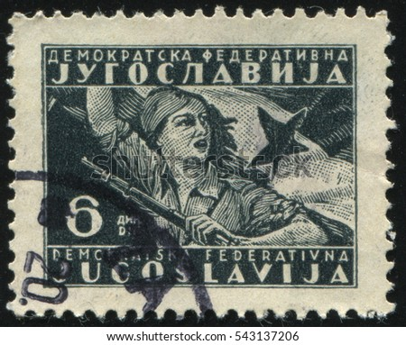 RUSSIA KALININGRAD, 12 NOVEMBER 2016: stamp printed by Yugoslavia, shows a woman holding a flag and a rifle, circa 1949