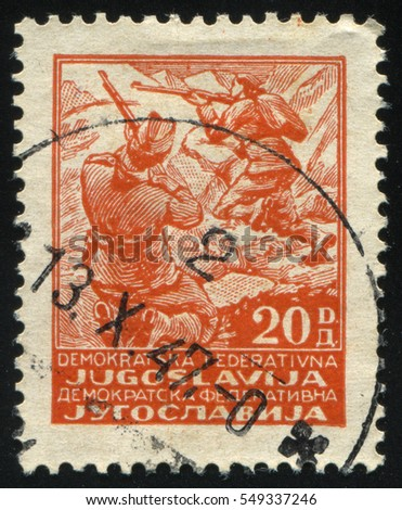 RUSSIA KALININGRAD, 12 NOVEMBER 2016: stamp printed by Yugoslavia, shows partisans, circa 1945