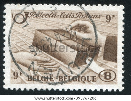 RUSSIA KALININGRAD, 20 OCTOBER 2015: A stamp printed by Belgium, shows Delivery of Parcel, circa 1948 - stock photo